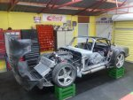 elan in new garage with reg plates removed from the wall reduced fot TC.jpg
